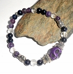 Amethyst Quartz and Goldstone Skull Bracelet